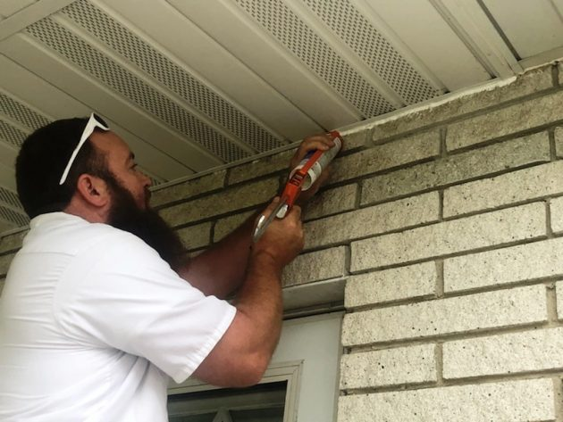 sealing a home for pest control by Erdye's Pest Control in Green Bay and Appleton Wisconsin